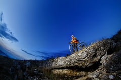 Mountain biker in action across rocks Stock Images