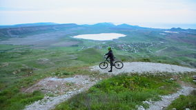 Mountain Biker Admiring Hilly Terrain stock video footage
