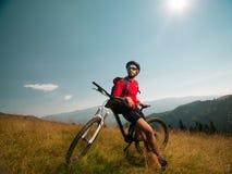 Mountain biker admiring the landscape Stock Images