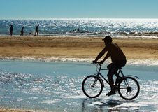 Mountain biker on the beach Royalty Free Stock Photography