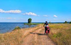 Mountain biker beside a beautiful river Royalty Free Stock Photography