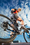 Mountain Biker and blue sky background Stock Photos