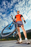 Mountain Biker and blue sky background Royalty Free Stock Image