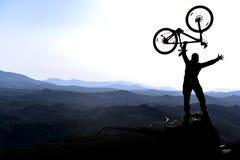 Mountain biker celebrates Royalty Free Stock Photos