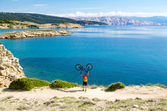 Mountain biker celebrating inspiring view at the sea Stock Photos