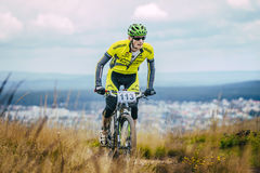 Mountain biker climbed top of the mountain Stock Images