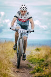 Mountain biker climbed top of the mountain Royalty Free Stock Image