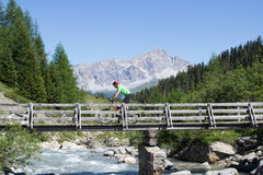 Mountain biker crossing bridge Royalty Free Stock Photos