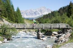Mountain biker crossing bridge Stock Image