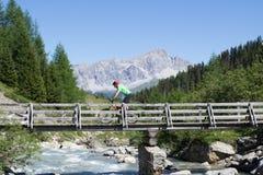 Mountain biker crossing bridge Royalty Free Stock Photos