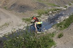 Mountain biker crossing river Stock Images