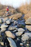 Mountain biker crossing a stream Royalty Free Stock Photo