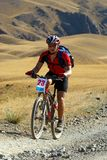 Mountain biker on desert race Stock Photo
