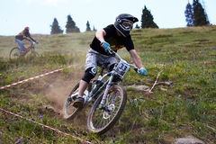 Mountain biker on downhill rce Stock Images