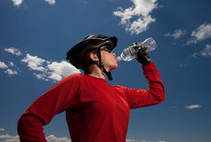 Mountain biker drinking from water bottle Royalty Free Stock Photography