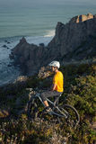 Mountain biker enjoying ocean view Stock Photo