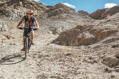 Mountain biker. Goes dow the mountain offroad Stock Images