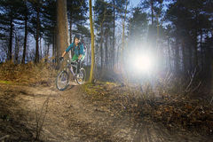 Mountain biker on a gravel trail at sunset Royalty Free Stock Photography