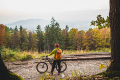 Mountain biker looking at inspiring forest landscape Stock Image