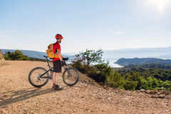 Mountain biker looking at the sea view Royalty Free Stock Photography
