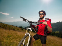 Mountain biker on a meadow Stock Images