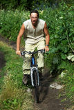 Mountain biker on old road in forest Royalty Free Stock Photos