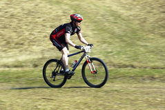 Mountain biker racing Stock Images