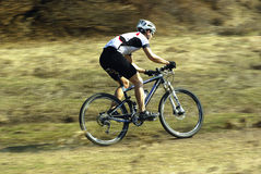 Mountain biker racing Stock Photos