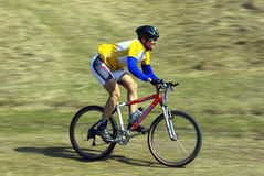 Mountain biker racing Royalty Free Stock Image