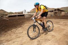 Mountain biker racing on old farm Stock Photo