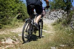 Mountain biker ride on a back-country stock photo