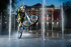 A mountain biker ride in fountain royalty free stock photography