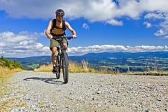 Mountain biker riding a bike in mountains Royalty Free Stock Photos