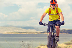 Mountain biker riding on bike at the sea Stock Photo