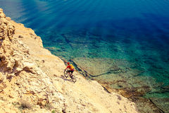Mountain biker riding bike at the seaside trail Stock Image