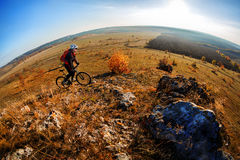 Mountain biker riding on bike at summer mountains. inspiration in beautiful inspirational landscape. Stock Photos