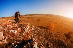 Mountain biker riding on bike at summer mountains. inspiration in beautiful inspirational landscape. Stock Photo