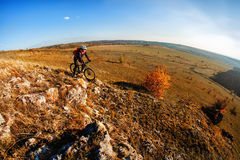 Mountain biker riding on bike at summer mountains. inspiration in beautiful inspirational landscape. Mountain biker riding on bike at summer mountains. Man royalty free stock photography