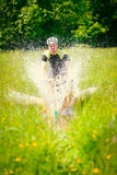 Mountain Biker Riding Through A Large Puddle Royalty Free Stock Photos