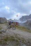Mountain biker riding though Swiss mountain area Stock Images