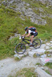 Mountain biker riding though Swiss mountain area Stock Photo