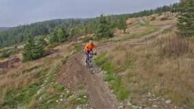 Mountain biker riding trails in Wales stock footage