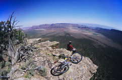 Mountain Biker On Rock Looking At View Royalty Free Stock Image