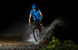 Mountain biker running through water Royalty Free Stock Photography