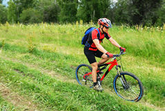 Mountain biker on rural road Royalty Free Stock Photo
