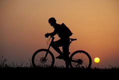 Mountain biker silhouette Stock Photos