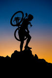 Mountain biker silhouette Stock Images