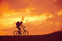 Mountain Biker silhouette in sunrise Royalty Free Stock Photography