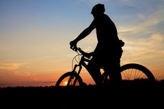 Mountain Biker Silhouette At Sunset Royalty Free Stock Images