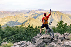 Mountain biker success, looking at mountains view Stock Image